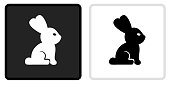 Rabbit Icon on  Black Button with White Rollover. This vector icon has two  variations. The first one on the left is dark gray with a black border and the second button on the right is white with a light gray border. The buttons are identical in size and will work perfectly as a roll-over combination.
