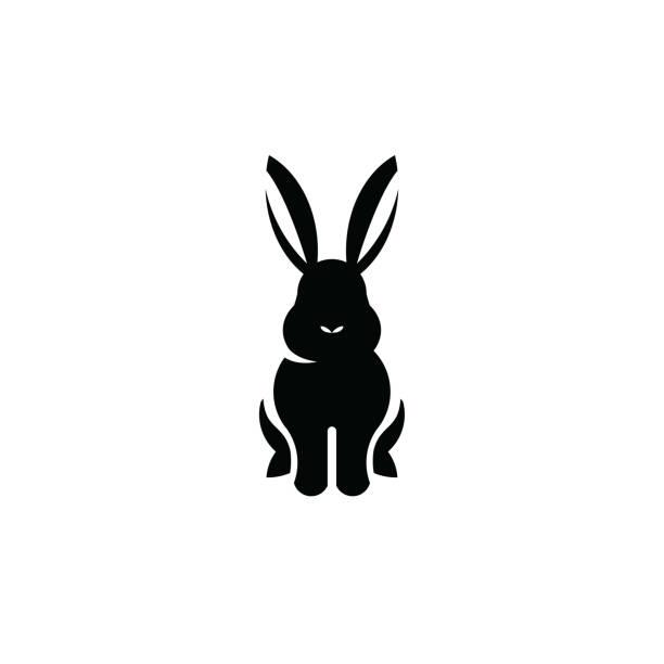 hase sitzend symbol isoliert auf weißem hintergrund - kaninchen stock-grafiken, -clipart, -cartoons und -symbole