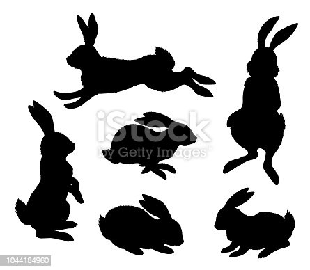 Rabbits. Set black silhouettes of hares in different poses.  Isolated on white background. Vector illustration
