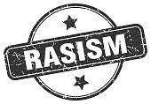 racism grunge stamp. racism round vintage stamp