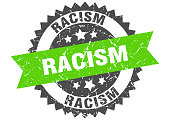 racism stamp. grunge round sign with ribbon