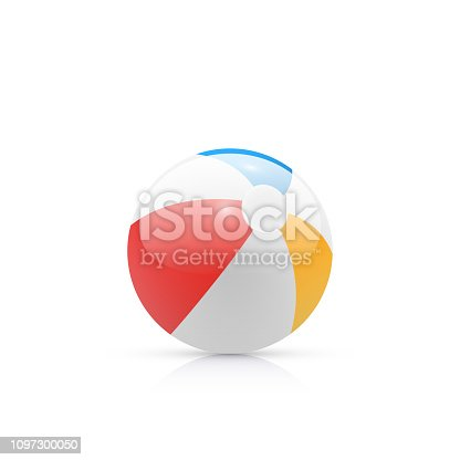istock Rainbow colored beach ball on plain background 1097300050