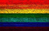 istock Rainbow LGBT flag on wood background 1226369471