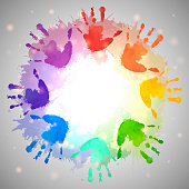 Rainbow prints of children hands and watercolor splashes in the circle. Vector frame for postcards and your design