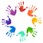 Rainbow prints of children hands in the circle. Vector frame for postcards and your design