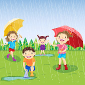Children play on a rainy day in spring.