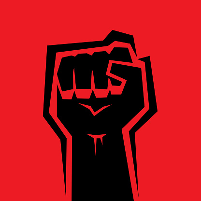 Vector illustration of a black raised fist against a red background.