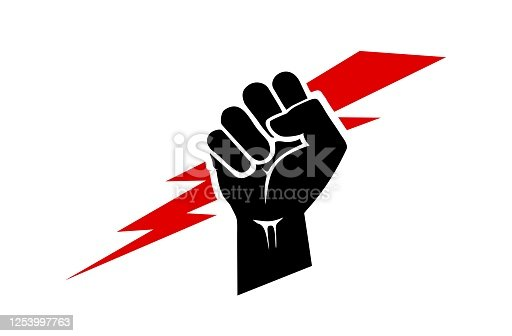 istock Raised hand icon, clenched fist with a lightning bolt. 1253997763