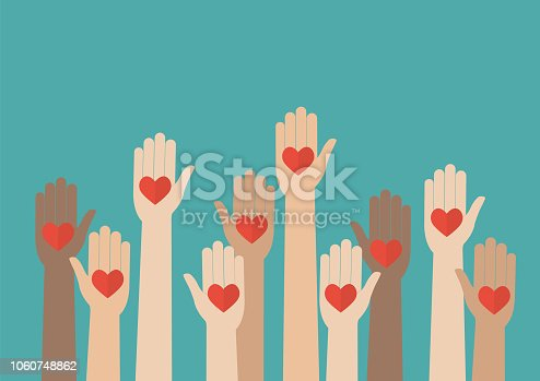 istock Raised hands volunteering 1060748862