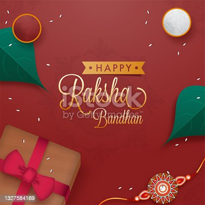 istock Raksha Bandhan Wishes with top point of view of a Rakhi, and Tilak on Betel Leaf. Indian festival of Brother and Sister Bond. 1327584169