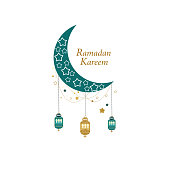 Ramadan Greeting card with gold and green colored moon, crescent and stars. Traditional lantern