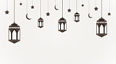 Ramadan Kareem background. Hanging lanterns, crescents and stars. Muslim feast of the holy month. Eid Mubarak greeting card template for Ramadan and Muslim Holidays. Vector