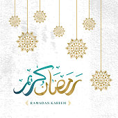 Ramadan kareem greeting design with arabic calligraphy and mandala on grunge background
