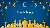 Ramadan Kareem the month of blessing Background Vector illustration. Night view of golden Mosque with hanging stars decoration