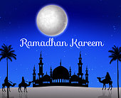 Ramadan kareem with walking camel caravan and silhouette mosque