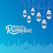 ramadan mubarak calligraphy with mosque and lantern paper art style
