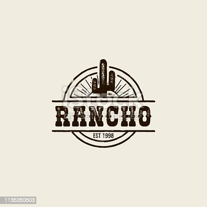 round logo ranch with a picture of a cactus. Vintage style, shabby background, monochrome colors. the emblem of the wild West