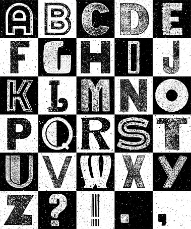 Black and white very wasted, random capital vintage alphabet on a squared grid. Vector vintage alphabet of capital letters in black and white on a squared grid. Very textured.  Layered file for easy editing.