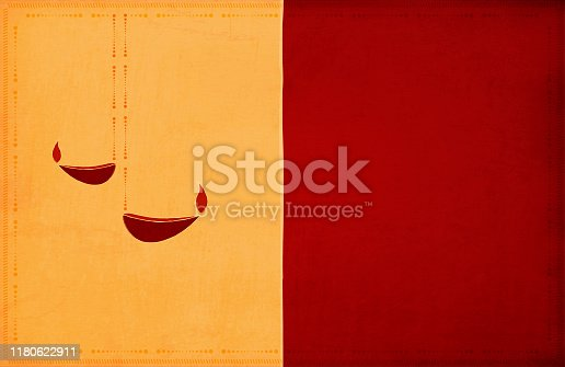 istock Rangoli - Two yellow, Dark red maroon color broad, wide vertical stripes, grunge background Diwali greeting with two diyas Diya and a border of dots and small angled lines 1180622911