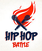 Rap Battle vector emblem with two microphones crossed and fire, Hip Hop hot rhymes music mic in a flames, concert festival or night club label, t-shirt print.
