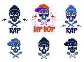 Rap music vector set emblems with aggressive skull and two microphones crossed like bones, Hip Hop rhymes festival concert or night club party labels, t-shirt prints.