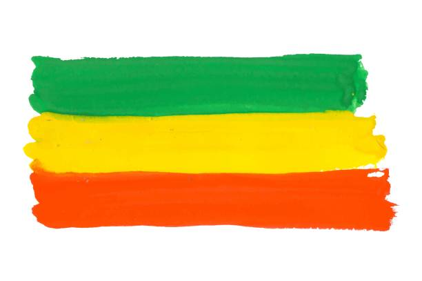 Rastafarian and Ethiopian flag drawn by paint on white, vector background with tricolor - red, yellow and green colors. Cannabis legalization and hippie lifestyle symbol concept. Colorful Rastafarian flag vector background rastafarian stock illustrations