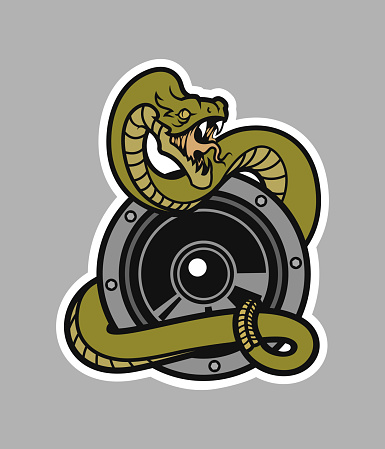 Rattlesnake with open mouth wrapped around a speaker