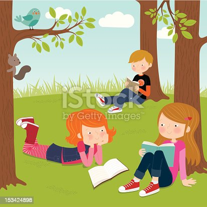 Children enjoying reading in the park