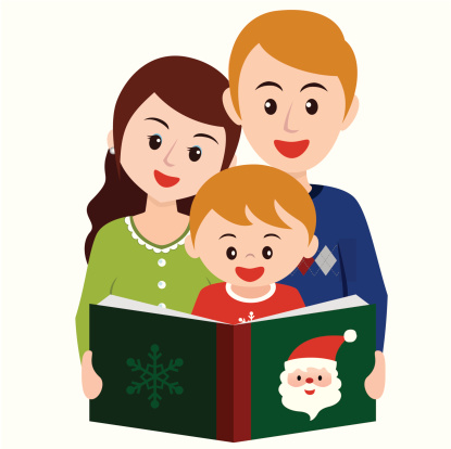Reading story book in Christmas time with family
