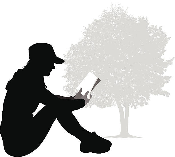 ReadingANovel A young, teenage girl reads a book outside under a tree. book silhouettes stock illustrations
