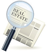 Real estate newspaper with magnifying glass