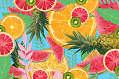 Fruity background. Pineapple, kiwi, watermelon, oranges and lemons background