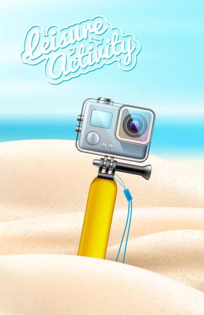 stockillustraties, clipart, cartoons en iconen met realistische actiecamera op strand zand achtergrond - gopro