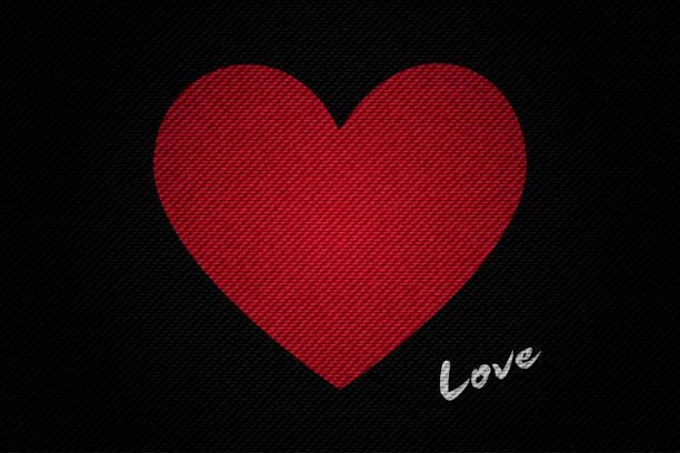 stockillustraties, clipart, cartoons en iconen met realistische black denim textuur van rood hart vector illustratie ontwerp voor valentijn concept idee - patchwork