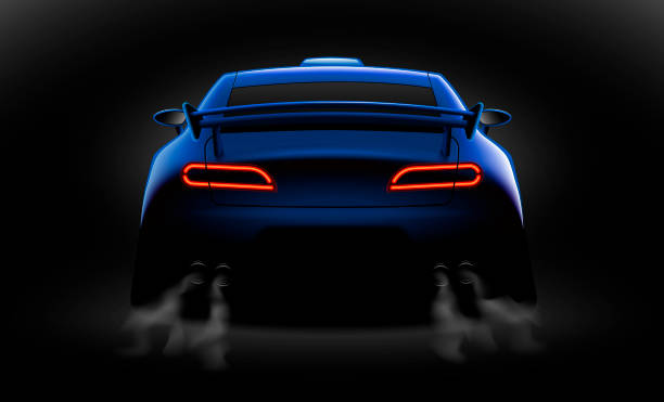 realistic blue sport car back view with unlocked rear lights in the dark realistic blue sport car back view with unlocked rear lights in the dark, vector illustration sports car stock illustrations