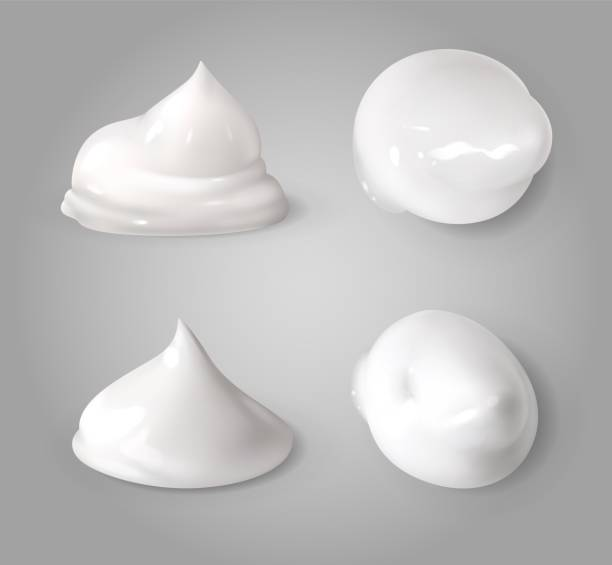 Realistic cream foam. White mousse or foaming milk gel drops light ointment beauty product vector texture forms Realistic cream foam. White mousse or foaming milk gel drops light ointment beauty body product vector texture forms pudding stock illustrations