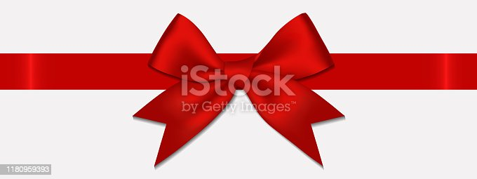 istock Realistic decorative shiny satin red ribbon bow, isolated on white background 1180959393