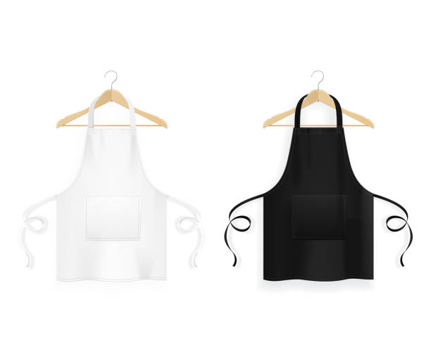 Realistic Detailed 3d Blank Black and White Kitchen Apron with Wooden Clothes Hangers Template Mockup Set. Vector Realistic Detailed 3d White Blank Black and White Kitchen Apron with Wooden Clothes Hangers Template Mockup Set. Vector illustration apron stock illustrations