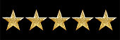 Realistic five shiny golden star set on black backdrop. Review rating, feedback, quality and opinion rank. Customers evaluation. Followers assessment. Best valuation. Vector illustration design