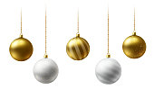 Realistic gold and  white  Christmas balls hanging on gold beads chains on white  background.  New Year background.