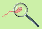 Realistic illustration magnifying glass and red worm.