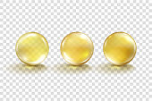 Realistic Oil gold bubble isolated on transparent background. Cosmetic pill capsule of vitamin E, A or argan oil. Golden glass ball template. Vector yellow serum droplet of drug or collagen essence.