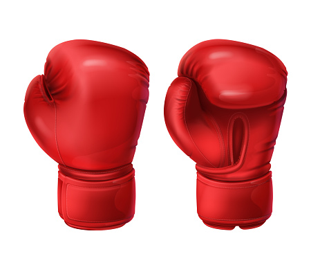 Realistic pairs of red boxing gloves