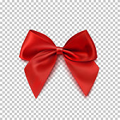 Realistic red bow isolated on transparent background.