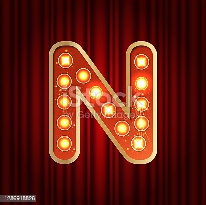 istock Realistic retro gold lamp bulb font letter N. Part of alphabet in vintage casino and slots style. Vector shine symbol of alphabet with golden light and sparkles on red curtains background show style 1286918826