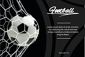 Realistic soccer ball in net isolated on black background. Classic football ball.