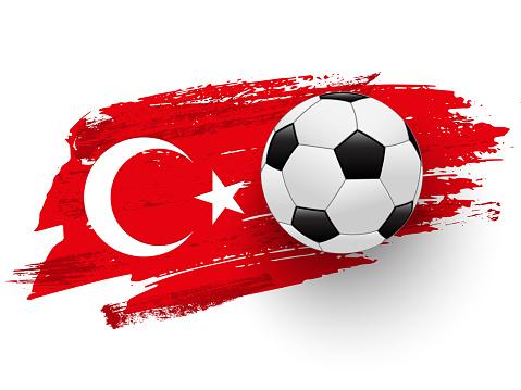 Realistic soccer ball on flag of Turkey made of brush strokes. Vector football design element.