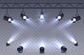 Realistic Spotlights isolated on transparent background. Scene illumination. Suspended and standing lighting. Elements for photo studio, show, scene. Vector illustration.