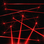 Realistic style laser beams on black background. Red intense beam of light produced by a laser. Vector illustration on dark background