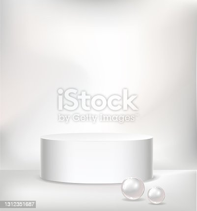 istock Realistic vector cylindric podium for your product design. Template contains one empty stage, light effects and pearls 1312351687